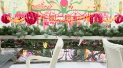 Decorated fir branches on fence near cafe chairs Stock Footage