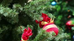 Red miniature balls, bags, toys on branch of artificial fir-tree Stock Footage