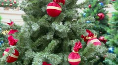 Colorful toy balls on branch of artificial fir-tree at shop Stock Footage