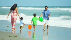 Hispanic family spending summer vacation on beach  - stock footage