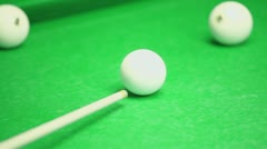 Cue beats billiard ball, closeup view on green table Stock Footage