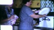 Stock Video Footage of WOMEN WASH DISHES Kitchen 1955 (Vintage Old Film Home Movie Footage) 6163