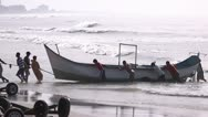 Fishermen removing the fishing boat from the sea Stock Footage