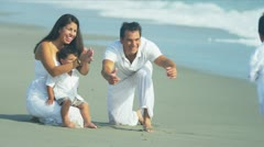 Latin American family spending summer holiday on beach  - stock footage