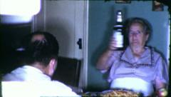 Alcoholic Grandmother Swings Beer Bottle 1960s Vintage Film Home Movie 6164 Stock Footage