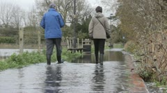 Flooded footpath wellies Stock Footage