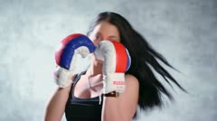 Sexy girl makes some boxing movement in gloves at photo studio Stock Footage