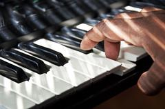 Hand Playing Keyboard - stock photo