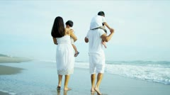 Latin American family enjoying summer holiday on beach  Stock Footage