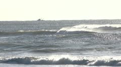 Waves crashing on the beach, horizon on a fishing boat Stock Footage