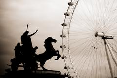 Monochrome photo of Queen Boudicca statue with the London Eye in the background Stock Photos