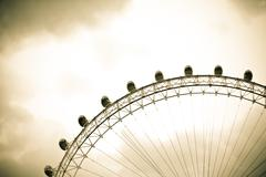 A section of The London Eye with a cloudy background - stock photo