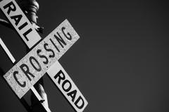 Monochrome railroad crossing sign Stock Photos