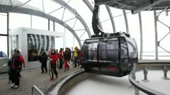 People go on ropeway station near lift cabins Stock Footage