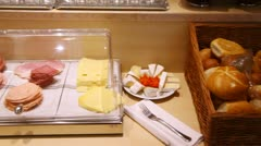 Bread, cheese and bacon stand on table in dining room Stock Footage