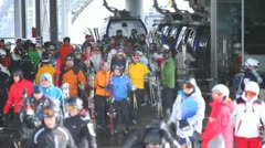 Skiers leave rope-way cabins on station. Stock Footage