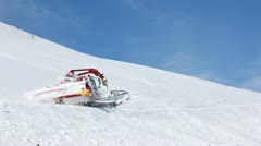 Snowplow cleans snow on mountain road in sunny weather Stock Footage
