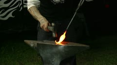 Stock Video Footage of Artisan blacksmith shaping a part of a sculpture.