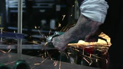 Worker using grinder on metal. Shooting Sparks. - stock footage