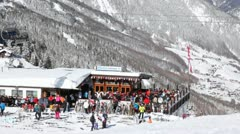 Crowd of skiers stands near point of hire of equipment. Stock Footage