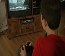 Teen plays video game Stock Footage