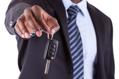 young african american businessman holding a car key. - stock photo