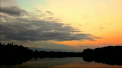 Time Lapse: Sunset in vibrant colors over a forest lake Stock Footage