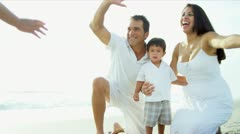 Latin American family embracing together by ocean  - stock footage