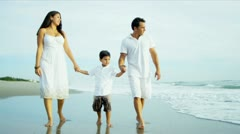 Hispanic parents spending leisure time with son by ocean  Stock Footage