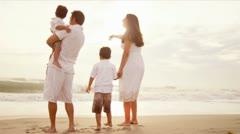 Summer beach walk of Latin American family sun lens flare  - stock footage