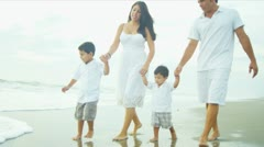 Hispanic family spending summer vacation on beach holding hands  Stock Footage