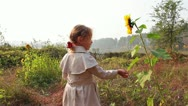 Cute child with sunflower in autumn field Stock Footage