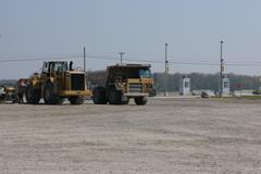 Bulldozer and Gravel Truck Stock Photos