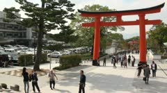 Tourists enter temple complex in Kyoto, an important city in Japan Stock Footage