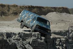 Van falling off cliff 01 - stock photo
