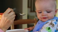 Mother feeds adorable baby boy Stock Footage