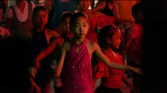 Dancing Chinese childrens crowd in the square at night. Stock Footage