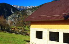 Villa being constructed in moutains - stock photo