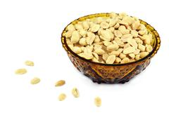 Salted peanuts in a bowl - stock photo