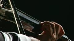 Man play dark wood violin Stock Footage