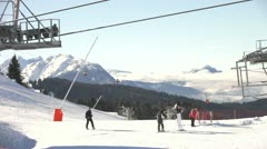 Time delay image showing people using facilities at busy ski resort Stock Footage
