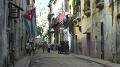 Havana, Cuban flag, Colonial buildings, streetview Stock Footage