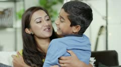 A mother showing her son lots of love Stock Footage