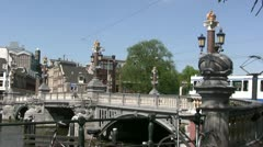 Tram going over bridge in Amsterdam - stock footage