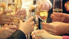Raising glasses for a toast - stock footage
