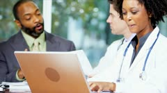 Multi Ethnic Medical Executives Meeting Financial Advisor Stock Footage