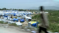 Haiti Tent city driving by steadily Stock Footage
