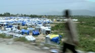 Stock Video Footage of Haiti Tent city driving by steadily