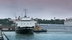 Tug-boat at the sea trading port Stock Footage