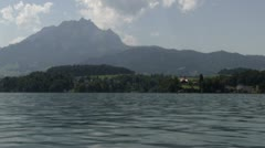 Giant mountain in Switzerland behind water Stock Footage